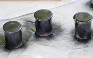 Spray painting glass votives from Dollar Tree black