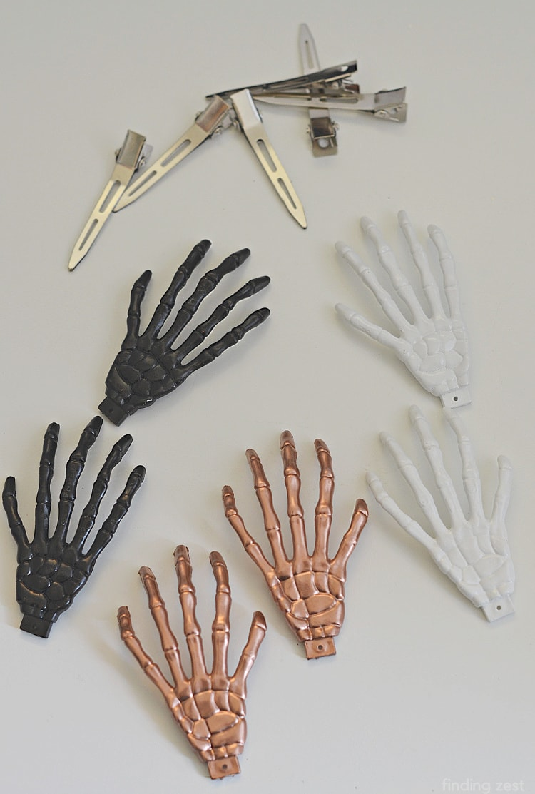 Spray painted plastic skeleton hands white, black and copper for hair accessories