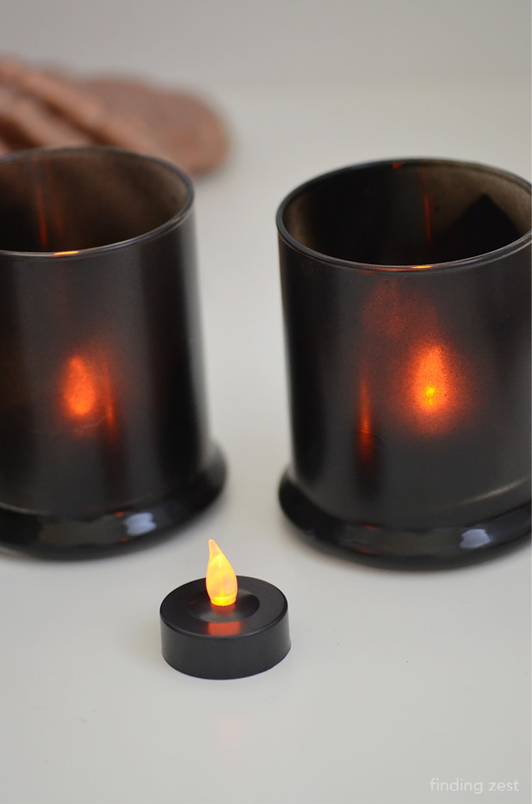 Adding LED teal light candles to spray painted glass votive holders