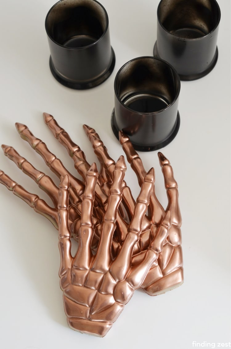 Skeleton hands from the dollar store spray painted copper metallic and black glass votives