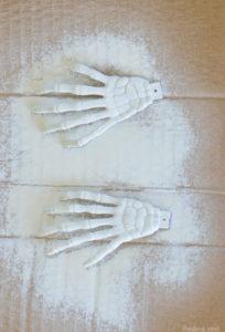 Plastic skeleton hands spray painted white for hair barette