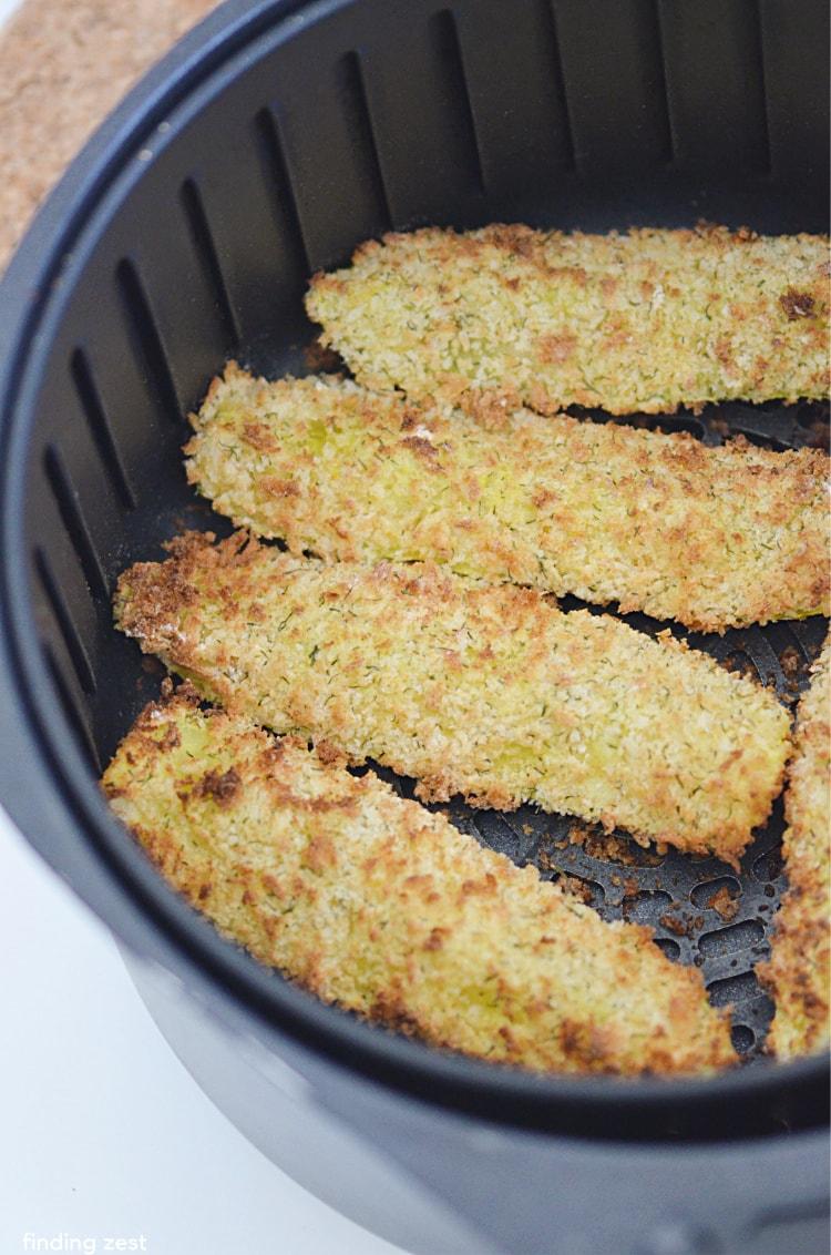 Breaded pickle spears in single layer in air fryer
