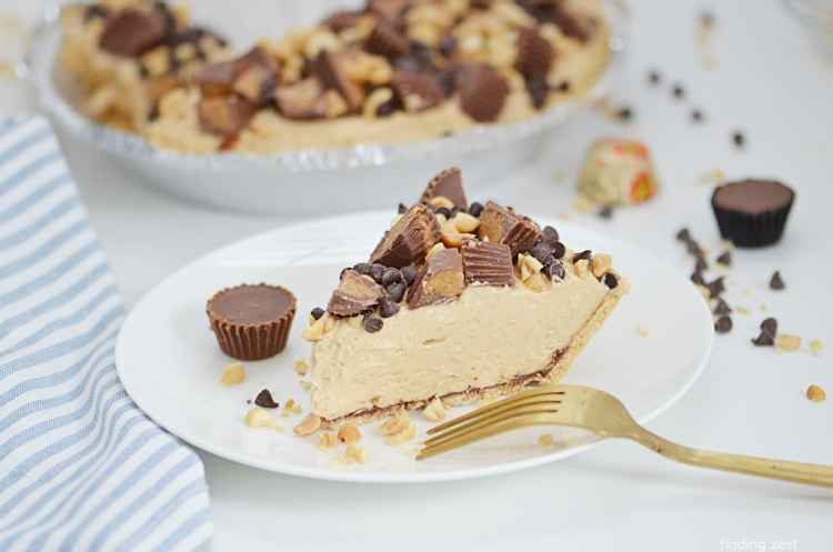 Taking a slice of no bake peanut butter pie on a dessert plate