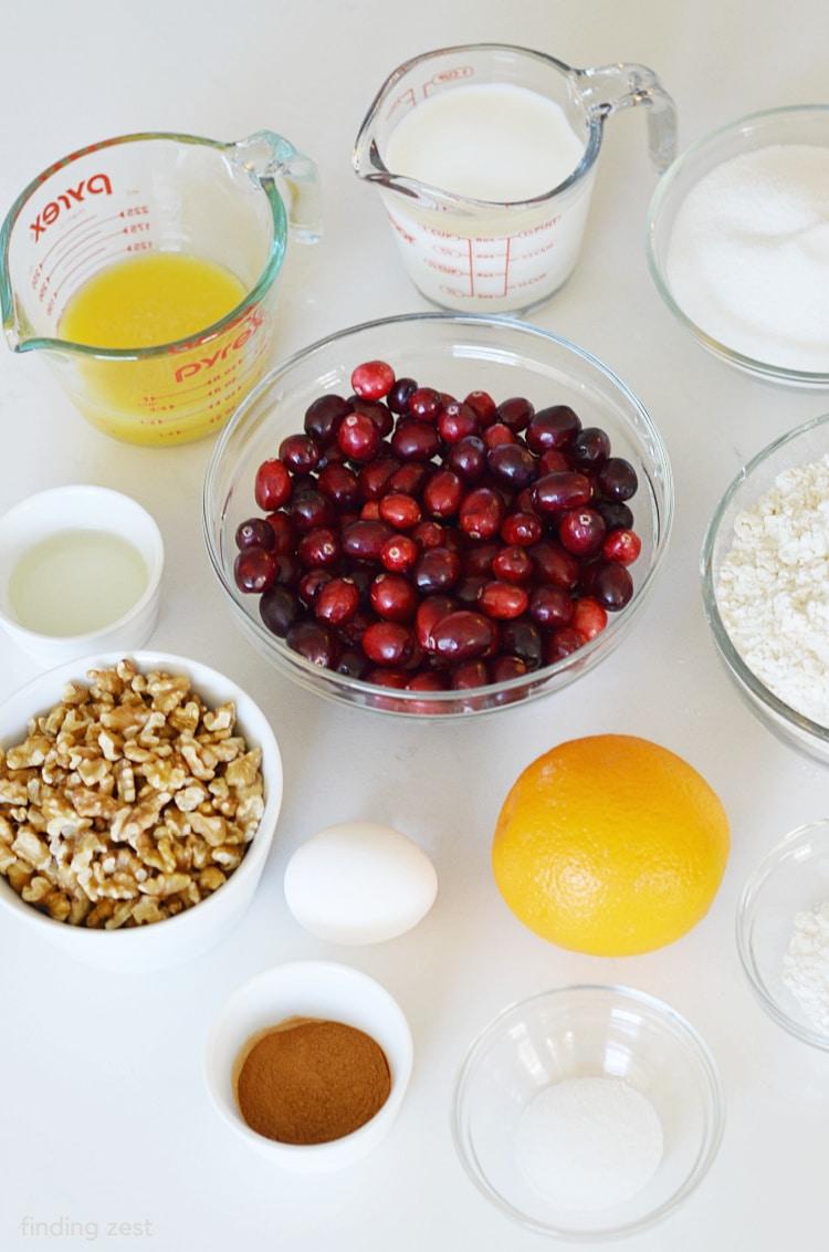 Ingredients for Cranberry Walnut Bread including fresh cranberries, orange , chopped walnuts, orange juice and milk