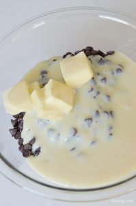 Chocolate Chips Butter Sweetened Condensed Milk in a bowl for fudge