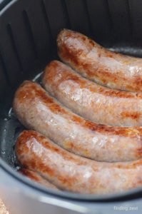 Brats that have just been cooked in an air fryer