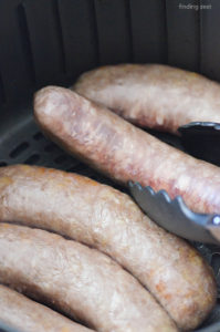 Turning Brats over halfway through cooking in an air fryer
