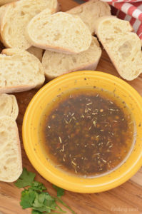 A simple olive oil dipping sauce for warm crusty bread served on the side.